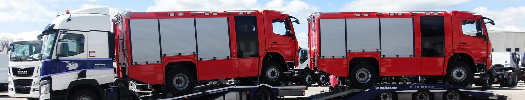 Camiones de bomberos en portavehiculos Pañalón